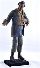 Lotto 125 - Uomo con copricapo in terracotta