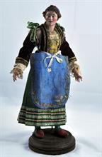Lotto 126 - Donna con copricapo e nastrino in terracotta.