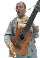 Lotto 4 - Figura da presepe di un cantante